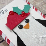"Penguin Ghirardelli treat wrap - a sweet Christmas gift idea! Penguin made with Many Mittens Framelits Dies, 1-3/8"" Circle Punch, Holly Berry Builder Punch, White Perfect Accents, Dark Cherry Cobbler Stampin' Blends Marker and a sentiment image from Seasonal Chums Stamp Set. Click here for directions!...#stampyourartout #stampinup - Stampin' Up!® - Stamp Your Art Out! www.stampyourartout.com"