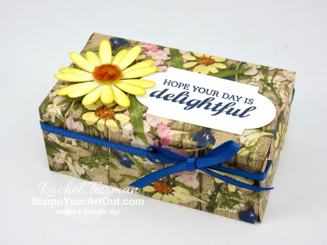 Click here to see how I made two beautiful gift boxes using the Perfect Parcel dies, the Pressed Petals lightweight designer paper, Slice of Happiness stamp set, and a beautiful double-layered daisy with a Perennial Essence Floral Center. Watch my video so you can see all my tips and tricks and get the step-by-step directions. You'll also be able to access measurements, other close-up photos, and links to the products I used. #stampyourartout #stampinup - Stampin' Up!® - Stamp Your Art Out! www.stampyourartout.com